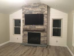 fireplace with magrahearth mantel and shiplap wall fireplace