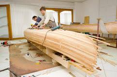tischlen design carpenters assembling new canoe of their own design stock