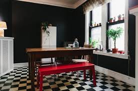 ways to make a small space feel bigger paint one wall dark