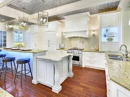 wood countertops kitchen island with columns lighting flooring