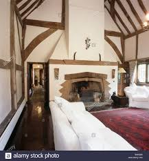 Red Oriental Rug Living Room White Sofa And Armchair In Large Barn Conversion Living Room With