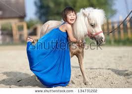 toddler petting little goats kids stock photo 586009988