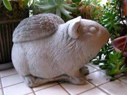 guinea pig statue concrete pig memorial remembrance figure