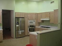 interior white wall theme and dark brown wooden kitchen cabinet