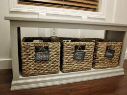 white entryway bench with labeled basket for shoe storage