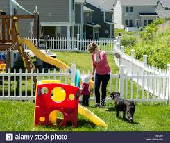 Dog Playground Equipment Backyard by Mother Small Child And Dog Play In Backyard Of Army Officer Stock