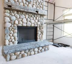 river rock stone fireplace condo pinterest stone fireplaces