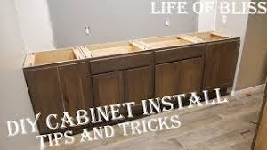cost to install base cabinets diy how to install base kitchen cabinets basement bar build
