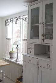 Kitchen Window Covering Ideas Metal Window Frieze Dresses Up The Window Without Blocking The