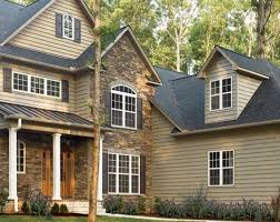like the stone and siding combo with the white posts and wood door