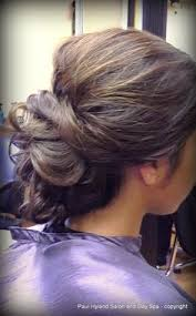 side view of pulled back hair in a bun special occasion hair with braid by jeannette paul hyland salon