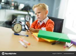 Kid At Desk by Young Boy At The Desk In The Office With Magnifier U2014 Stock Photo