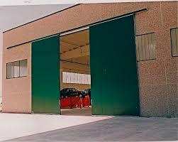 porte per capannoni porta scorrevole in metallo per hangar industriale ps 3000