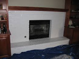nice white painted fireplace with wooden mantel also grey wall