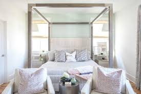 Wood Canopy Bed White Chairs In Front Of Gray Wood Canopy Bed Transitional Bedroom