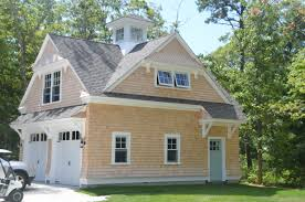 i like the 2nd floor of garage with this cross gable roof or