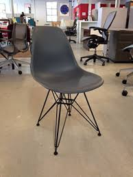 Molded Plastic Armchair An Eames Molded Plastic Chair In Charcoal Grey By Herman Miller