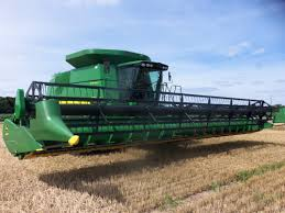 john deere 9770 sts combine with 635f wheat header raised up