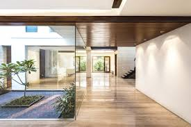 counting on indian style a sleek home design comes with interior awesome hallway lighting fixtures and glass courtyard wall panel feat wooden ceiling idea