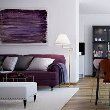 modern living room with swing arm floor lamp and purple sofa