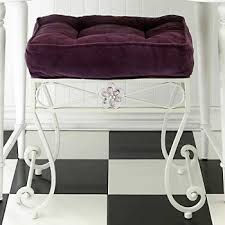 white vanity stool with purple velvet cushion