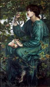 the dark haired model is dressed in green and seated in a sycamore tree