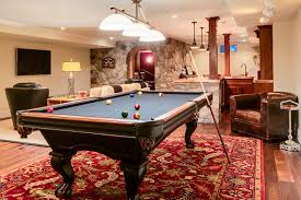 pretty mizerak pool table in family room traditional with video