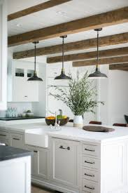 Lighting Kitchen Pendants Rustic Beams And Pendant Lights A Large Kitchen Island