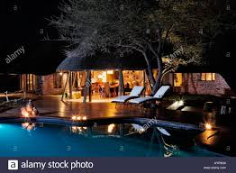 exterior of the villa and swimming pool at night an exclusive