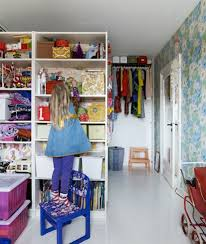 Room Dividers For Kids - floral wallpaper and billy bookcases create a pretty solution in a