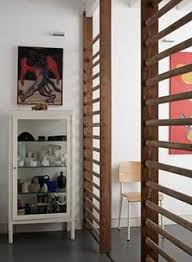 Karalis Room Divider 15 Creative Ideas For Room Dividers A Wood Panel Wall Separates
