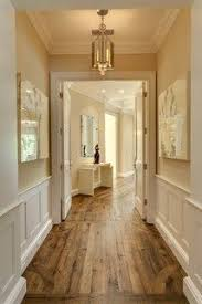 rustic plank flooring with prestine white wainscoting home