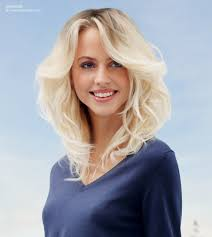 dark roots blonde hair long blonde hair with waves and natural darker roots