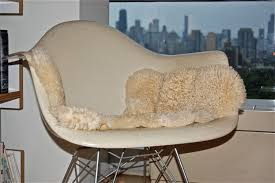 furniture chic eames rocking chair with fur blanket and picture