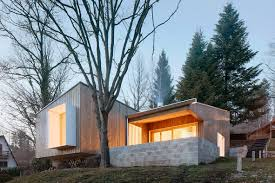 prefab cottage designed as a cost conscious summer retreat curbed