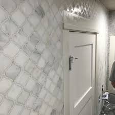 carrara white marble arabesque lantern tile shower bathroom