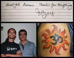 religious om symbol in sun design on back shoulder