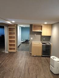 valley custom cabinets custom built ins custom cabinets natural maple bar area bookcase w wood soffit basement remodel st paul mn