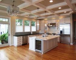 kitchen with exposed beams in ceiling with hanging lanterns