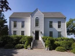 wbn home design inc two faced beach house hides modern behind colonial facade curbed