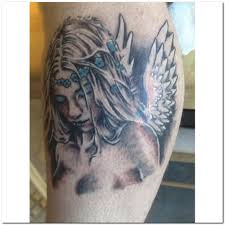 sad angel tattoo design with grey ink photos pictures and