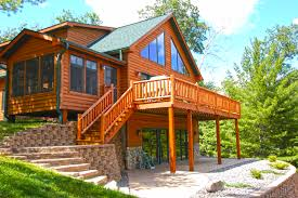 a cedar sided chalet with a screened in porch chalets by