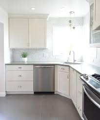 white kitchen with gray plank porcelain tile floor transitional