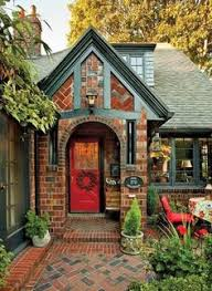 a small stone lake house in minnesota craftsman black door and