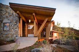 Colorado Home Builders Laminate Timbers Outside At Entry Roof Overhang Stone Exterior