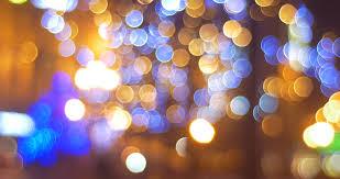 blurred lights of garlands on a fir trees light balls net square