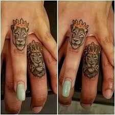 finger tattoo lioness 50 romantic ring tattoo designs to immortalize your love