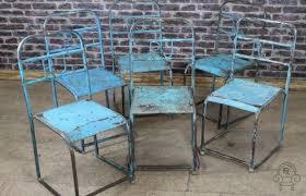 vintage industrial metal chairs light blue