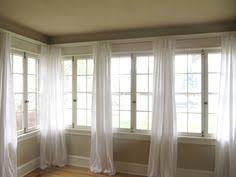 How Wide To Hang Curtains Diy Galvanized Pipe Curtain Rod Hang Curtains High And Wide To