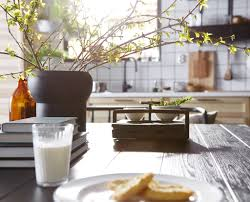 tips for a modern swedish kitchen a close up of a dark wood dining table with plants